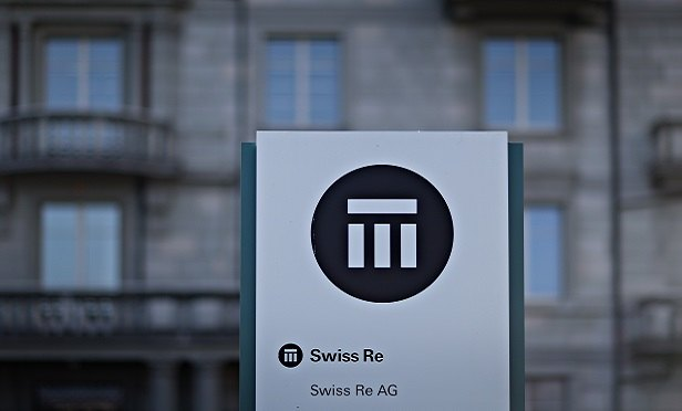 A logo sits on a sign outside Swiss Re AG's headquarters in Zurich, Switzerland, on Thursday, March 10, 2016. The Swiss economy returned to growth at the end of last year as it fought off the impact of a currency shock that had threatened to push the country into a recession. Photographer: Michele Limina/Bloomberg