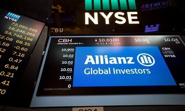 A monitor displays Allianz Global Investors GmbH signage on the floor of the New York Stock Exchange (NYSE) in New York, U.S., on Monday, July 3, 2017. U.S. stocks rose in light trading and the dollar strengthened as factory data bolstered optimism in the strength of the American economy. Crude climbed for an eighth day.