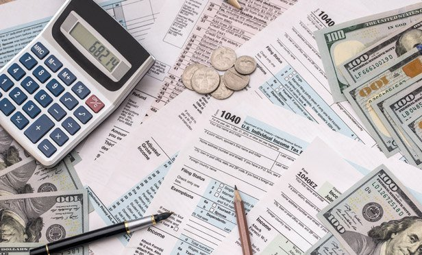 Tax forms, calculator and money