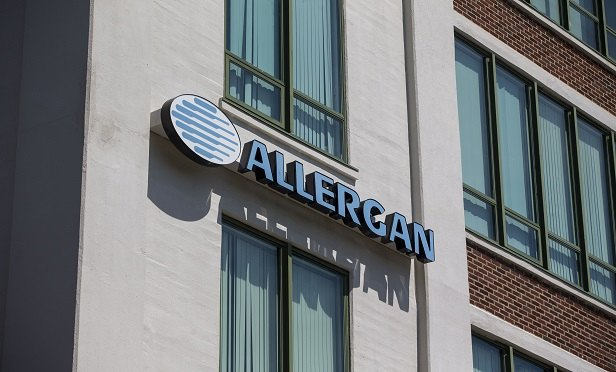 Allergan Plc. signage is displayed on the exterior of the company's office in Medford, Massachusetts, U.S., on Friday, Aug. 5, 2016. Allergan Plc. is scheduled to release earnings figures on August 8. Photographer: Scott Eisen/Bloomberg
