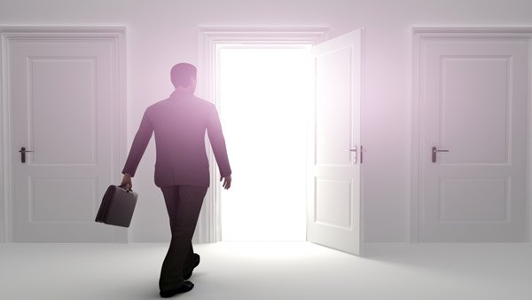 A sales rep walking toward a door