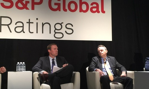 Robert Hauff and Thomas Gallagher share the podium at an S&P insurance conference in New York. (Photo: Allison Bell/TA)