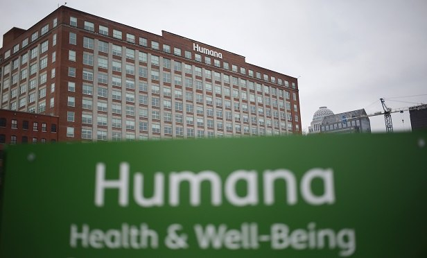 Signage is displayed outside the Humana Inc. office building in Louisville, Kentucky, U.S., on Saturday, Nov. 26, 2016. The Justice Department sued in July to block the union of Aetna Inc. and Humana Inc., saying they would reduce the number of large, national health care insurance providers, leading to increased costs for their clients. Photographer: Luke Sharrett/Bloomberg
