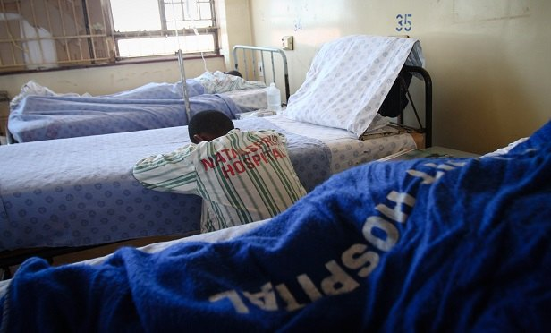 "Patients wearing hospital-branded pyjamas sleep in the general ward of Natalspruit hospital in Katlehong, South Africa, on Monday, Sept. 19, 2011. ""There is a base of 28.5 million people in the African market where there will be demand for the healthcare,"" Andre Meyer, Medscheme Ltd.'s chief executive officer said. Photographer: Nadine Hutton/Bloomberg"