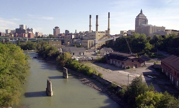 The Eastman Kodak Co. headquarters building is pictured at right in this image of the Genesee River and the skyline of downtown Rochester, New York, on Friday, September 6, 2003. The plunge in Kodak shares to an 18-year low on Thursday has deepened concern among the factory workers and retail employees in Rochester who rely on Kodak for their livelihoods. Photographer: Doug Benz/Bloomberg News