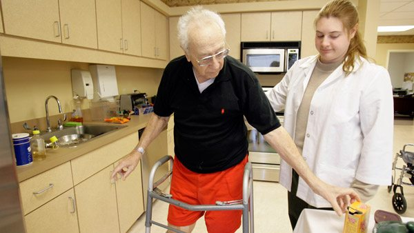 Patient being assisted in a nursing home. (Photo: AP)