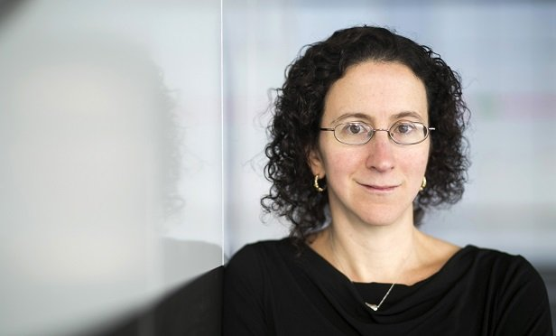 MIT Ford Professor of Economics Amy Finkelstein, who studies the economics of health and healthcare, poses for a portrait at MIT in Cambridge, Massachusetts, U.S., on Wednesday, Dec. 11, 2013. Photographer: Kelvin Ma/Bloomberg