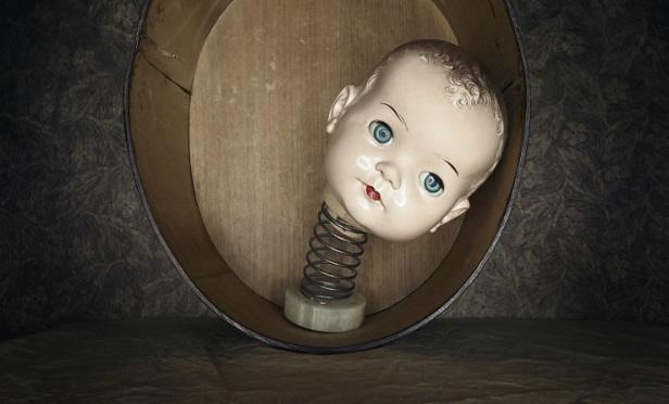 A creepy baby head on a spring