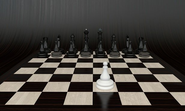 A chessboard, with one pawn against a lot of pieces from the other side