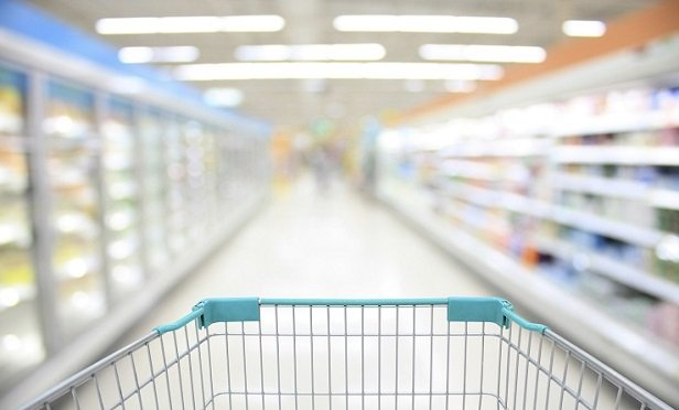 Shopping Cart View in Supermarket Aisle Milk Yogurt Frozen Food Freezer and Shelves with customer defocus background(Photo: iStock)