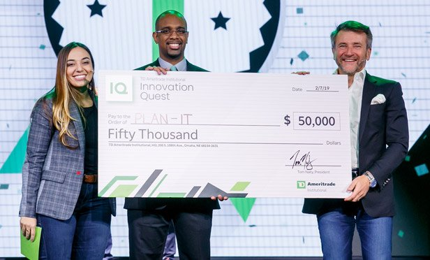 TD Ameritrade Institutional's Dani Fava and Shark Tank's Robert Herjavec present Innovation Quest winner's check to Derrick Wesley of iMar Learning Solutions at the LINC 2019 conference