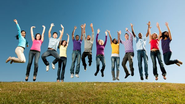 Happy young people jumping
