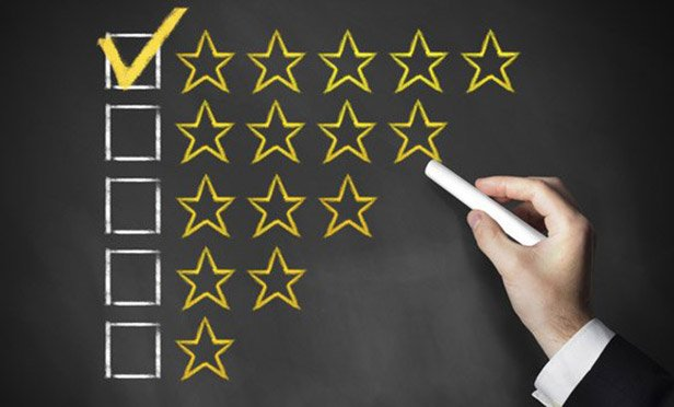 stock image of a business person checking off boxes with stars next to them