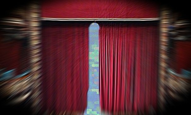 Blue light behind a theater curtain