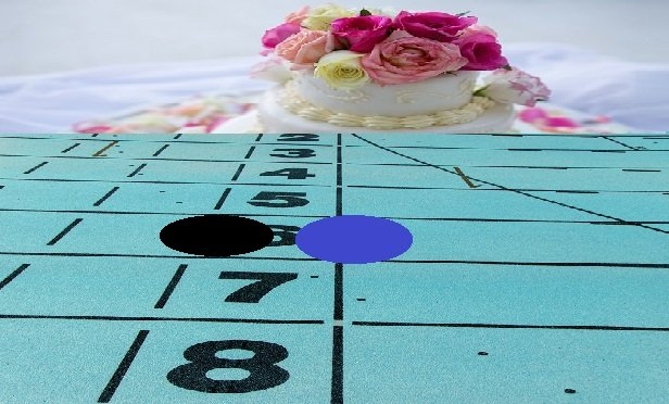 A gameboard finish line heading to a wedding cake