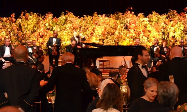 Musicians play during the Carnegie Hall Opening Night gala is shown at the Waldorf Astoria in New York, U.S., on Wednesday, Oct. 3, 2012. In the ballroom, an orchestra serenaded guests as they mingled. Photographer: Amanda Gordon/Bloomberg