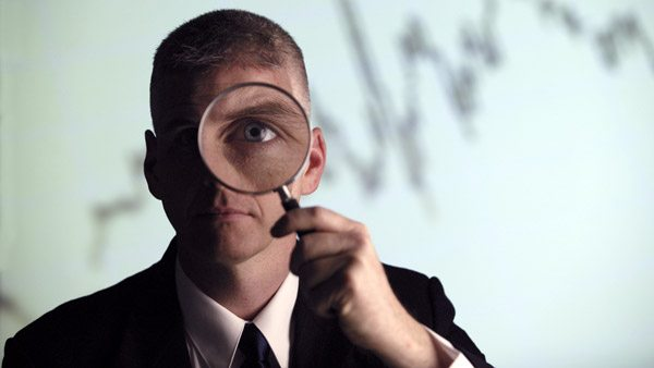 SEC exam, man with mangifying glass