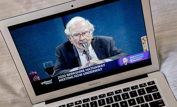 Image of Warren Buffett on a computer screen from Bloomberg