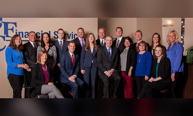 image of staff with JFC Financial Services standing as a group of about 15 people