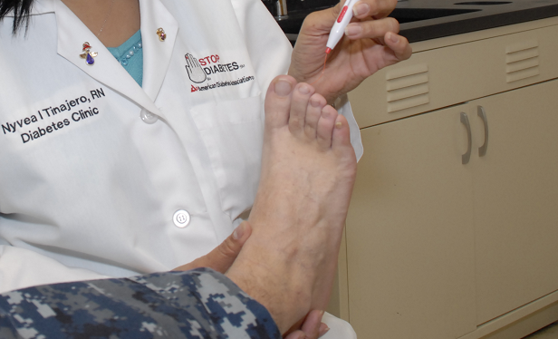 A nurse at Naval Hospital Jacksonville cares for the foot of a patient with diabetes. (Credit: Michelle Pereira/U.S. Navy/Wikimedia Commons)