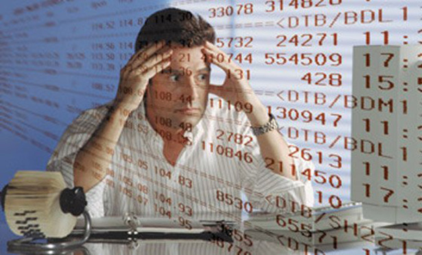 Stock image of worried man looking at numbers