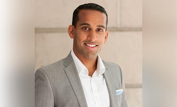 headshot of Merrill exec Parikh Nilesh