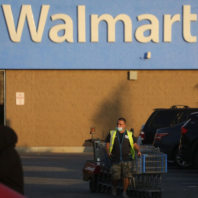 Walmart Lures Goldman Bankers in Bid to Fight Wall Street
