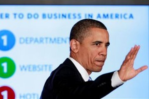 President Barack Obama waves after delivering remarks on government reform, Friday, Jan. 13, 2012. (AP Photo/Haraz N. Ghanbari)