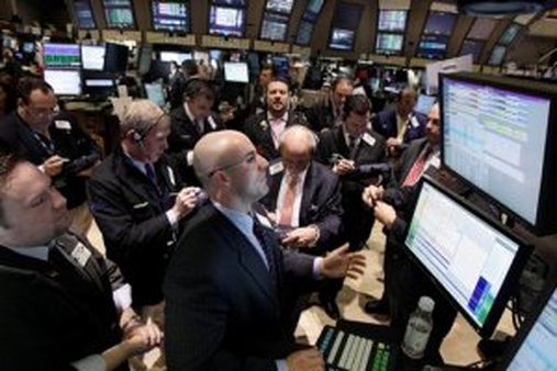 Specialist Henry Becker, foreground center, directs trades in share of MetLife on the floor of the New York Stock Exchange Thursday, March 3, 2011. (AP Photo/Richard Drew)