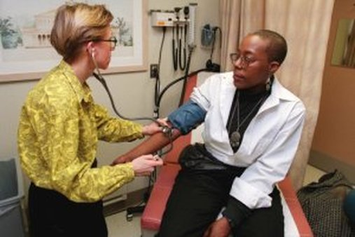 Nayla Rolle gets a medical exam in New York. (AP Photo/Stuart Ramson)