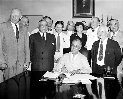 On Aug. 14, 1935, President Franklin Roosevelt signs the Social Security Bill in Washington. Roosevelt favored creating national health insurance, but decided to push for Social Security first. He never gets the health program passed. (AP Photo/File)