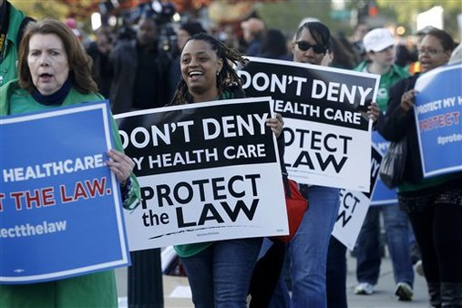 Supporters of the health care reform law signed by President Obama gather in front of the Supreme Court in Washington, Monday, March 26, 2012. (AP Photo/Charles Dharapak)