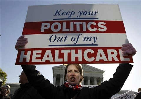Amy Brighton from Medina, Ohio, who opposes PPACA, rallies in front of the Supreme Court in Washington, Tuesday, March 27, 2012. (AP Photo/Charles Dharapak)