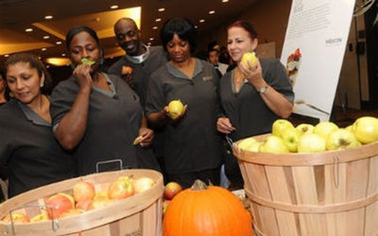 Employees at the Westin Times Square sample a variety of produce for the launch of Westin Hotels & Resorts' new wellness program in New York (Diane Bondareff/AP Images for Westin Hotels & Resorts)