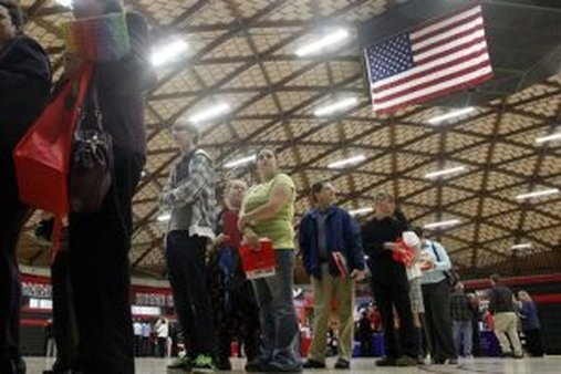 In this April 10, 2012, file photo, people wait in a line at a job fair in Gresham, Ore. The state releases its latest jobless figures, Tuesday, April 17, 2012. (AP Photo/Rick Bowmer, file)