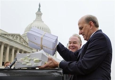 Rep. Louie Gohmert, R-Texas and Rep. Tom Price, R-Ga. with their copies of PPACA. (AP Photo/J. Scott Applewhite)
