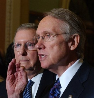 Sen. Harry Reid, D-Nev., and, in the background, Sen. Mitch McConnell, R-Ken. Photo credit: AP Images