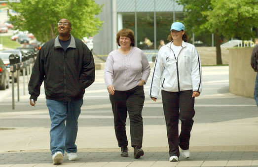 In this AP file photo, Principal Financial Group employees participate in an employee wellness program