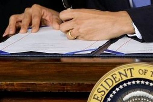 "<p style=""color:#FFF8C6;"">President Obama signs PPACA. (AP Photo/J. Scott Applewhite)</p>"
