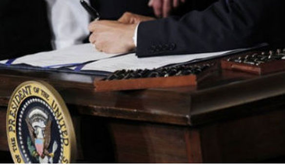 President Barack Obama signs the health care reform bill in the East Room of the White House in Washington, Tuesday, March 23, 2010. (AP Photo/Charles Dharapak)