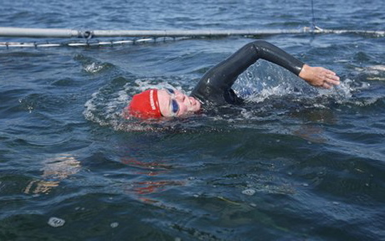 If you thought it was hard to cross the Atlantic swimming--just try it with insurance agreements (AP Photo/J Pat Carter)