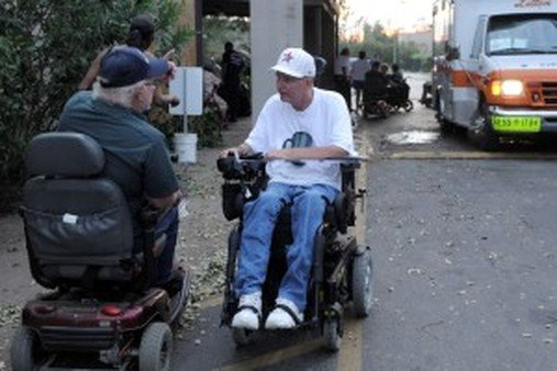 Residents of a complex for the elderly who reportedly were told to fend for themselves after Hurrican Ike hit Houston in September 2008. (AP Photo/Pat Sullivan)