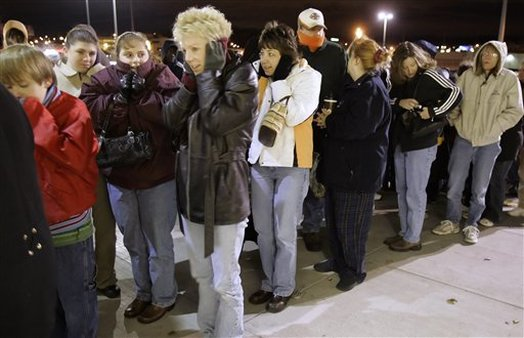 Shoppers line up in sub freezing temperatures as they wait for the Kohl's department store to open at 5 a.m. in Omaha, Neb. (AP Photo/Nati Harnik, file)