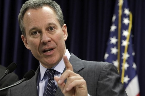 New York Attorney General Eric Schneiderman answers a question during a news conference in his New York City office. (AP photo)
