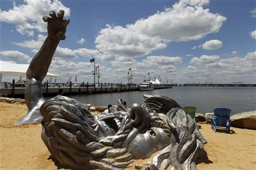 """The Awakening"" sculpture in the sand in the National Harbor in Oxon Hill, Md. (AP Photo/Alex Brandon)"