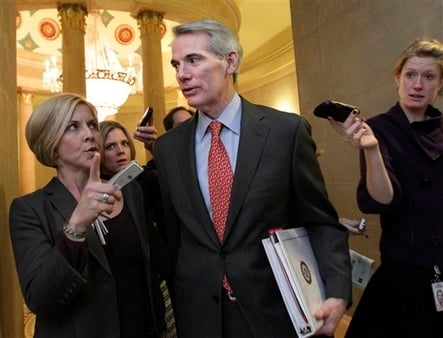 Sen. Rob Portman, R-Ohio, a member of last year's failed Joint Select Committee on Deficit Reduction, pursued by reporters on Capitol Hill. (AP Photo/J. Scott Applewhite, File)