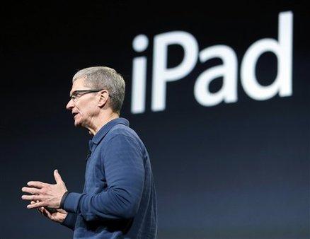 Apple CEO Tim Cook announces new products, including the iPad mini, Oct. 23, 2012. (AP Photo/Marcio Jose Sanchez)