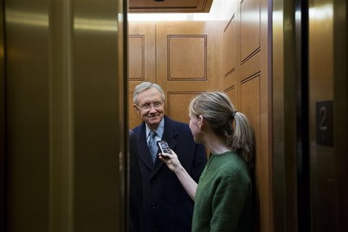 Senate Majority Leader Harry Reid, left, from Nevada, departs the Capitol after a vote about the fiscal cliff, Jan. 1, 2013. (AP/Alex Brandon)