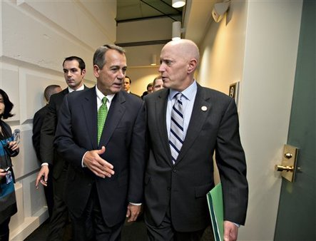Late on New Year's Day, Speaker of the House John Boehner and House Ways and Means Committee Chairman Dave Camp confer as they leave a closed-door meeting of House Republicans. (AP/J. Scott Applewhite)
