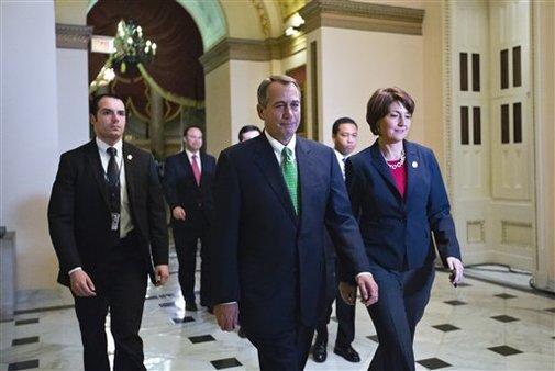 John Boehner and Rep. Cathy McMorris Rodgers arrive at the House of Representatives, Jan. 1, 2013. (AP/J. Scott Applewhite)